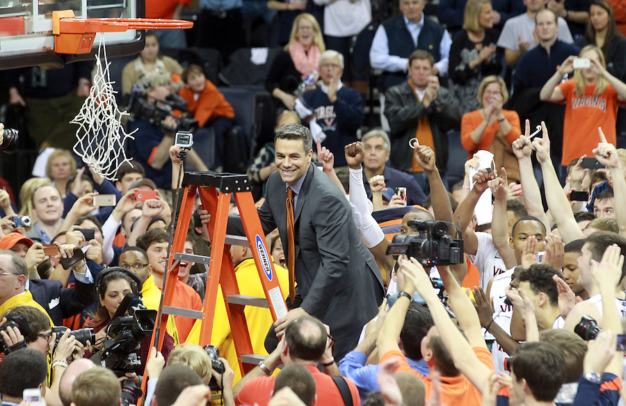Virginia head coach Tony Bennett prepares to cut his piece of net to celebrate winning the ACC title after defeating Syracuse 75-56 Saturday March 1, 2014 during an NCAA basketball game in Charlottesville, VA.