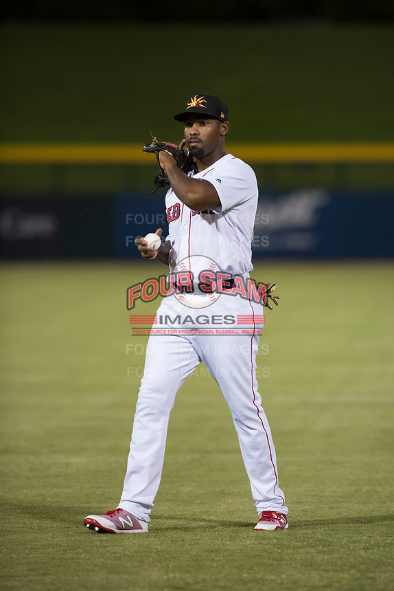 Mesa Solar Sox first baseman Josh Ockimey (28), of the Boston Red Sox organization, warms up before an Arizona Fall League game against the Scottsdale Scorpions at Sloan Park on October 10, 2018 in Mesa, Arizona. Scottsdale defeated Mesa 10-3. (Zachary Lucy/Four Seam Images)