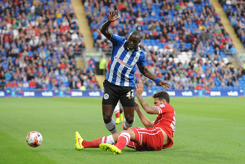 Cardiff City&rsquo;s Sean Morrison tackles Wigan Athletic's Marc-Antoine Fortun&eacute;<br /> <br /> Photographer Ian Cook/CameraSport<br /> <br /> Football - Cardiff City v Wigan Athletic - Sky Bet Championship - Tuesday 19th August 2014 - Cardiff City Stadium - Cardiff <br /> <br /> &copy; CameraSport - 43 Linden Ave. Countesthorpe. Leicester. England. LE8 5PG - Tel: +44 (0) 116 277 4147 - admin@camerasport.com - www.camerasport.com