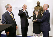 Langley, VA - May 31, 2006 -- New Central Intelligence Agency (CIA) Director General Michael Hayden, right, is ceremonially sworn in by National Intelligence Director John Negroponte, as United States President George W. Bush, left, and Mrs. Jeanine Hayden look on, at CIA headquarters in Langley, Virginia Wednesday 31 May 2006. Hayden, the former head of the super-secret National Security Agency (NSA), was officially sworn-in yesterday in a closed ceremony.<br /> Credit: Matthew Cavanaugh-Pool via CNP