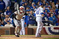 Cleveland Indians catcher Roberto Perez Perez (55) tags Wilson Contreras (40) to complete the strikeout in the sixth inning during Game 4 of the Major League Baseball World Series against the Chicago Cubs on October 29, 2016 at Wrigley Field in Chicago, Illinois.  (Mike Janes/Four Seam Images)