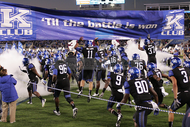 UK players run onto the field before the first half of UK's blackout home game against Mississippi State at Commonwealth Stadium in Lexington, Ky., on Saturday, Oct. 29, 2011. Mississippi State won 28-16. Photo by Tessa Lighty | Staff