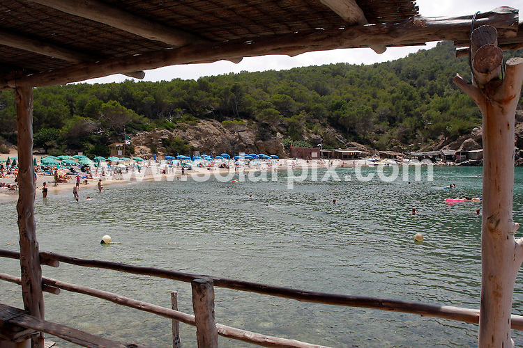 **ALL ROUND EXCLUSIVE PICTURES FROM SOLARPIX.COM**.**WORLDWIDE SYNDICATION RIGHTS**.Prime ministers wife Samantha Cameron spent a weeks  holiday with their children and friends on the party Island of Ibiza in Spain...This pic: Benirras Beach where Samantha Cameron and children spent the afternoon swimming...JOB REF: 11749       AB1       DATE:24.07.2010.**MUST CREDIT SOLARPIX.COM OR DOUBLE FEE WILL BE CHARGED**.**MUST AGREE FEE BEFORE ONLINE USAGE**.**CALL US ON: +34 952 811 768 or LOW RATE FROM UK 0844 617 7637**