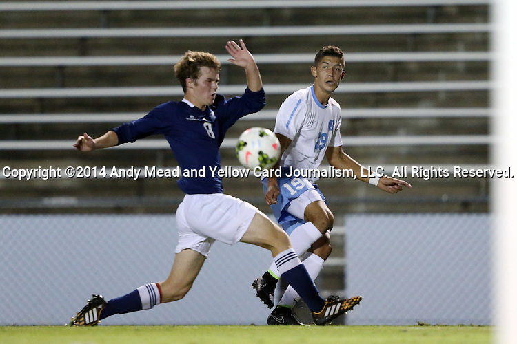 28 October 2014: North Carolina's David October (ENG) (19) crosses past Georgia Southern's Matt Melton (8). The University of North Carolina Tar Heels hosted the Georgia Southern University Eagles at Fetzer Field in Chapel Hill, NC in a 2014 NCAA Division I Men's Soccer match. North Carolina won the game 6-2.