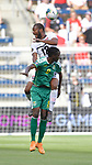 Sheldon Holder (9) of Guyana (front) and Carlyle Mitchell (12) of Trinidad and Tobago leap for a header during their Gold Cup match on June 26, 2019 at Children's Mercy Park in Kansas City, KS.<br /> Tim VIZER/AFP