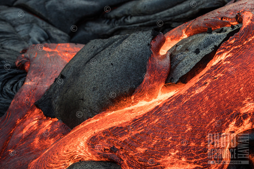 Lava flows over and through the coastal plains of Pulama Pali, Hawai'i Volcanoes National Park, Puna, Hawai'i Island, January 2018.