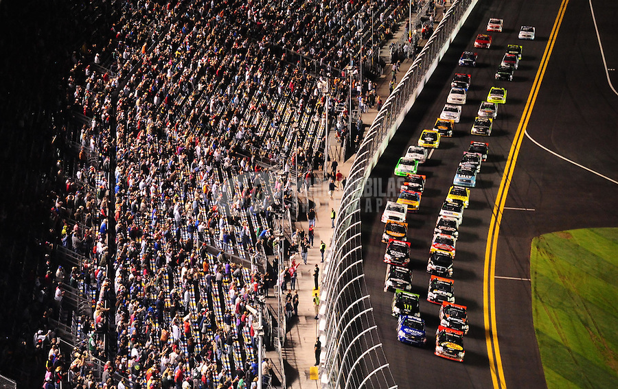 Feb 18, 2011; Daytona Beach, FL, USA; NASCAR Camping World Truck Series drivers come to the green flag to begin the NextEra Energy Resources 250 at Daytona International Speedway. Mandatory Credit: Mark J. Rebilas-