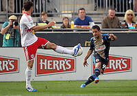 CHESTER, PA - OCTOBER 27, 2012:  Danny Cruz (44) of the Philadelphia Union swings in a cross by  Heath Pearce (3) of the New York Red Bulls during an MLS match at PPL Park in Chester, PA. on October 27. Red Bulls won 3-0.