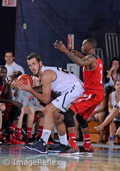 Florida International University center Ivan Jurkovic (25) plays against the University of Louisville.  Louisville won the game 85-56 on December 21, 2013 at Miami, Florida.
