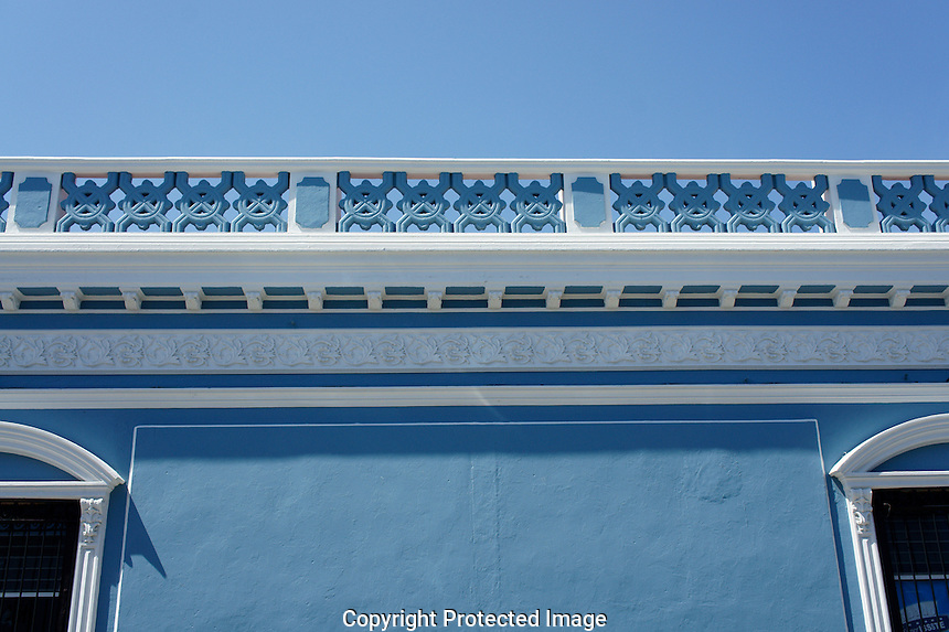 Blue facade and roofline of a Spanish colonial house in Merida, Yucatan, Mexico