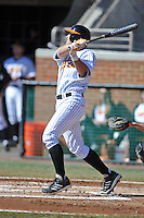 Designated hitter Nick Senzel #13 of the Tennessee Volunteers swings at a pitch during a game against the UNLV Runnin' Rebels at Lindsey Nelson Stadium on February 22, 2014 in Knoxville, Tennessee. The Volunteers defeated the Rebels 5-4. (Tony Farlow/Four Seam Images)