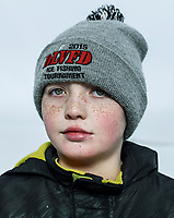 Parker Stearns, age 11, during the 39th Annual International Eelpout Festival, at Leech Lake in Walker, Minnesota, February 24, 2018. Crowds that are more than 10 times the population of tiny Walker, Minn. (pop. 1,069) gather on Minnesota&rsquo;s third largest lake (112,000-acres), Leech Lake, for a festival named for one of the ugliest bottom-dwelling fish, the eelpout.<br /> <br /> Photo by Matt Nager