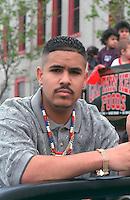 Man age 23 looking worried at Cinco de Mayo festival.  St Paul  Minnesota USA