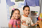 Preschool ages 3-5 closeup portrait of a boy and a girl friends horizontal