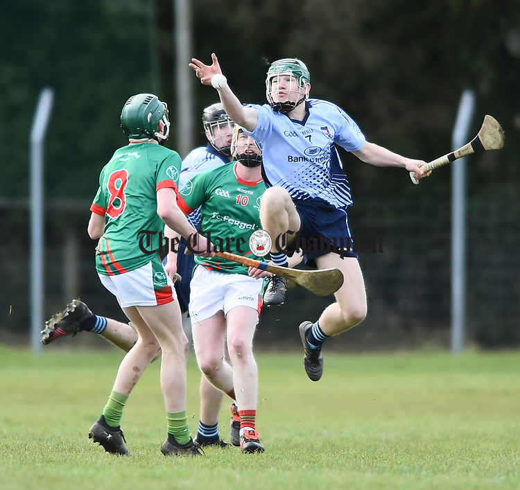 Kevin Drost of Scariff Community College in action against Diarmaid Conway and Chris Wrafter of St Fergal's College during their All-Ireland Colleges final at Toomevara. Photograph by John Kelly.