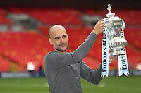 Manchester City manager Pep Guardiola with the trophy<br /> <br /> Photographer Rob Newell/CameraSport<br /> <br /> Emirates FA Cup Final - Manchester City v Watford - Saturday 18th May 2019 - Wembley Stadium - London<br />  <br /> World Copyright © 2019 CameraSport. All rights reserved. 43 Linden Ave. Countesthorpe. Leicester. England. LE8 5PG - Tel: +44 (0) 116 277 4147 - admin@camerasport.com - www.camerasport.com