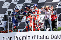 Ducati's Team rider Italian Andrea Dovizioso, winner, Maverick Vinales of Spain  and Movistar Yamaha MotoGP second, Danilo Petrucci of Italy and OCTO Pramac Racing third during the Moto GP Grand Prix at the Mugello race track on June 4, 2017 celebrates on the podium. <br /> MotoGP Italy Grand Prix 2017 at Autodromo del Mugello, Florence, Italy on 4th June 2017. <br /> Photo by Danilo D'Auria.<br /> <br /> Danilo D'Auria/UK Sports Pics Ltd/Alterphotos /NortePhoto.com