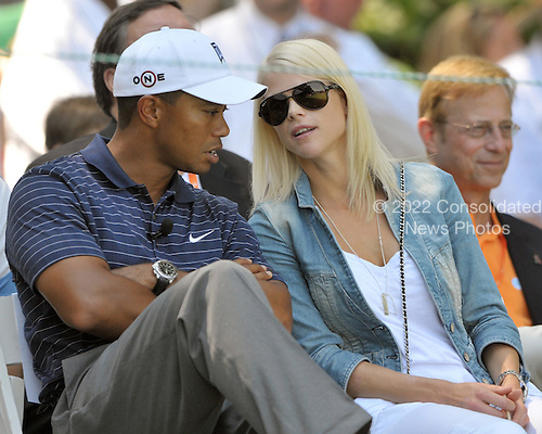 Bethesda, MD - July 1, 2009 -- Tiger Woods, left, and his wife, Elin Nordegren, right, share some thoughts during the opening ceremonies of the AT&T National Hosted by Tiger Woods at Congressional Country Club in Bethesda, Maryland on Wednesday, July 1, 2009..Credit: Ron Sachs / CNP