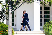 US President Donald J. Trump (R) and First Lady Melania Trump (L) walk down the Colonnade of the West Wing of the White House after returning from paying their respects to late US Supreme Court Justice John Paul Stevens as he lies in repose in the Great Hall of the Supreme Court, in Washington, DC, USA, 22 July 2019.<br /> Credit: Michael Reynolds / Pool via CNP
