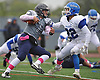 Plainview JFK quarterback No. 7 Kevin Pastier, left, dodges a tackle before running for a touchdown in the second quarter of a Nassau County Conference I varsity football game against Port Washington at Plainview JFK High School on Saturday, October 3, 2015. Plainview JFK won by a score of 42-0.<br /> <br /> James Escher