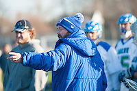 Salve Regina Men's Lacrosse Head Coach Patrick Cooney instructs his team from the sidelines as they play Anna Maria at Gaudet Field in Middletown.