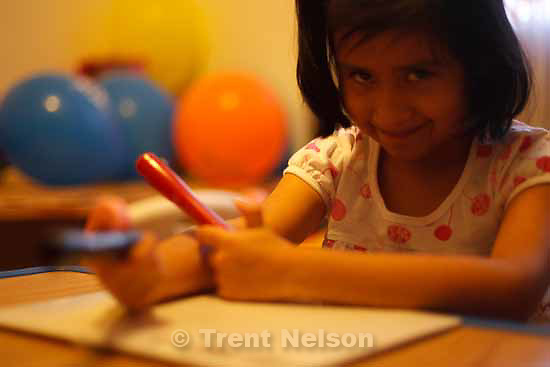 """Kimberly Rodriguez, 7, has been diagnosed with autism. Her mother, Diosa Rodriguez, says Kimberly is just learning how to """"pretend play."""" Friday, December 4 2009 in Salt Lake City."""