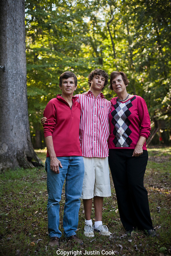 "Genia Smith, her partner Becky Burks and son Christopher Smith-Burks, 14. Together for 32 years. Hillsborough, NC. ""Marriage is a legality, you don't need a preacher to get married."" Genia says she ""couldn't care less about an actual marriage ceremony,"" instead she just wants the legal rights that every other couple with a marriage license has."