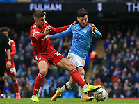 26th January 2020; Etihad Stadium, Manchester, Lancashire, England; English FA Cup Football, Manchester City versus Fulham; David Silva of Manchester City takers on Ivan Cavaleiro of Fulham