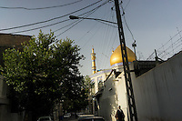 June 12, 2014 - Tehran (Iran). A cleric walks in a neighborhood of south Tehran. © Thomas Cristofoletti / Ruom