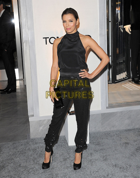 EVA LONGORIA.The Opening of The Tom Ford Beverly Hills Store in Beverly Hills, California, USA..February 24th, 2011.full length sleeveless top hand on hip sparkly sequins sequined shoes clutch bag trousers black  .CAP/RKE/DVS.©DVS/RockinExposures/Capital Pictures.