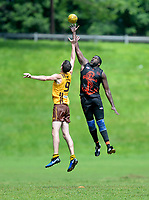 Baltimore's Tracy Williams (45) leaps upward to take a centre bounce jump ball over Philadelphia's Brian Simkus (9). The Philadelphia Hawks defeated the Baltimore Dockers 44-21 in USAFL game 6-9-18 in Baltimore, MD.