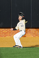 Wake Forest Demon Deacons left fielder Grant Shambley (43) tracks a fly bal against the Marshall Thundering Herd at Wake Forest Baseball Park on February 17, 2014 in Winston-Salem, North Carolina.  The Demon Deacons defeated the Thundering Herd 4-3.  (Brian Westerholt/Four Seam Images)