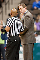 February 25, 2010:     Robbie Laing, Campbell head coach, discusses a play with the official during Atlantic Sun Conference action between the Jacksonville Dolphins and the Campbell Camels at Veterans Memorial Arena in Jacksonville, Florida.  Jacksonville defeated Campbell 65-52.