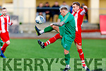 Kerry DL's James Sugrue and Sean O'Shea of Limerick Desmond League go toe to toe for possession in the Oscar Traynor Trophy game in Mounthawk Park on Sunday.