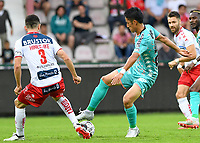 KORTRIJK , BELGIUM - AUGUST 03 : Ryota Morioka of Charleroi pictured in a duel with Brandan Hines-Ike of Kortrijk (3) during the Jupiler Pro League match day 2 between Kv Kortrijk and Sporting Charleroi on August 03 , 2019 in Kortrijk , Belgium . ( Photo by David Catry / Isosport )