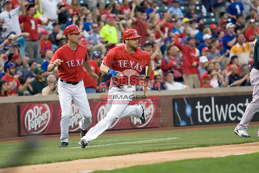 Texas Rangers outfielder Craig Gentry (23) rounds third and heads home against the Oakland Athetics in American League baseball on May 11, 2011 at the Rangers Ballpark in  Arlington, Texas. (Photo by Andrew Woolley / Four Seam Images)