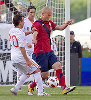Spain midfielder Santiago Cazorla (20) dribbles as USA midfielder Michael Bradley (4) defends. In a friendly match, Spain defeated USA, 4-0, at Gillette Stadium on June 4, 2011.