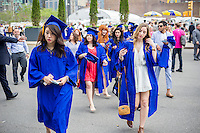 Graduating students from the Fashion Institute of Technology arrive at the Jacob Javits Convention Center in New York on Thursday, May 19, 2016 for the college's commencement exercises.  (© Richard B. Levine)