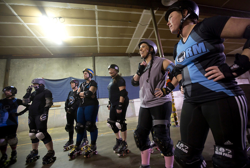 Storm City Roller Girls discuss their practice in Vancouver Thursday February 9, 2017. (Photo by Natalie Behring for the Columbian)