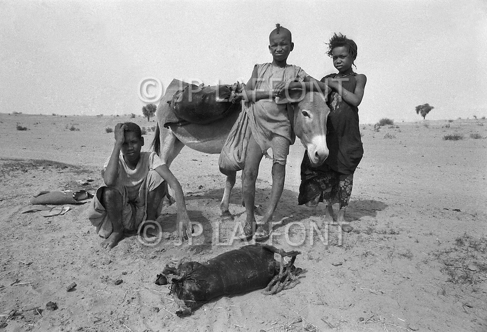 Children born into slavery work to collect drinking water over great distances in the area of Boutlimit, Mauritania. Bags of water are made with animal skins. - Child labor as seen around the world between 1979 and 1980 – Photographer Jean Pierre Laffont, touched by the suffering of child workers, chronicled their plight in 12 countries over the course of one year.  Laffont was awarded The World Press Award and Madeline Ross Award among many others for his work.