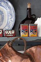 Vintage stock cube tins on display in the kitchen
