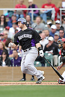 Chris Iannetta #20 of the Colorado Rockies plays in a spring training game against the Arizona Diamondbacks at Salt River Fields on February 26, 2011  in Scottsdale, Arizona. .Photo by:  Bill Mitchell/Four Seam Images.