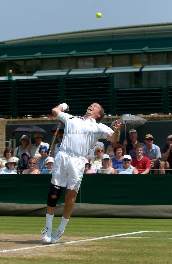 Photo: Richard Lane..Wimbledon Championships. 04/07/2006. .Great Britain's John Lloyd during an over 45 mens doubles match