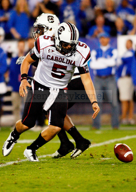 The Gamecocks quarterback Stephen Garcia drops the ball after the snap in the second half of UK's 31-28 win over  South Carolina football on Saturday, Oct. 16, 2010. Photo by Britney McIntosh | Staff