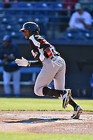 Hickory Crawdads second baseman Travis Demeritte (25) runs to first during game one of a double header against the Asheville Tourists on April 21, 2015 in Asheville, North Carolina. The Crawdads defeated the Tourists 10-1. (Tony Farlow/Four Seam Images)