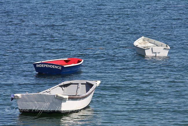 "Three row boats in water, one named, ""Independence""."