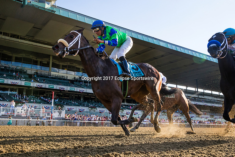 ELMONT, NY - JUNE 09: By The Moon #9 and Rajiv Maragh win the Bed o' Roses Invitational Stakes at Belmont Park on June 9, 2017 in Elmont, New York. (Photo by Alex Evers/Eclipse Sportswire/Getty Images)