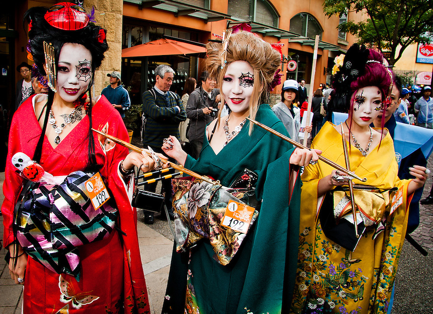 3 Japanese girls in colorful Halloween make up & Kimono`s walking the streets of Kawasaki,