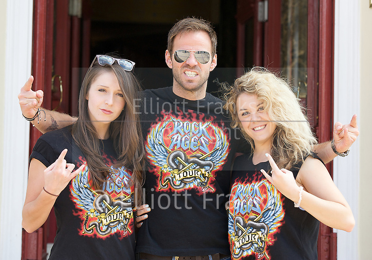Ben Richards in Rock of Ages <br /> publicity press photocall<br /> outside the New Wimbledon Theatre, London, Great Britain <br /> 9th September 2014 <br /> <br /> Ben Richards<br /> who plays Stacee Jaxx<br /> <br /> with Cordelia Farnworth <br /> and Jessie May (blonde hair) who both appear in the show which starts at the New Wimbledon Theatre in November 2014. <br /> <br /> Photograph by Elliott Franks <br /> Image licensed to Elliott Franks Photography Services