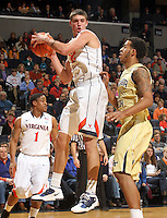 Jan. 22, 2011; Charlottesville, VA, USA; Virginia Cavaliers guard Joe Harris (12) grabs a rebound in front of Georgia Tech Yellow Jackets guard Glen Rice Jr. (41) during the game at the John Paul Jones Arena. Mandatory Credit: Andrew Shurtleff-US PRESSWIRE